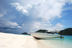 Speed boat on the beach. White speed boat on the beach Royalty Free Stock Photography