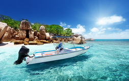 Speed boat on the beach of Coco Island stock images