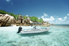 Speed boat on the beach of Coco Island royalty free stock photography