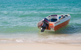 Speed boat on beach Royalty Free Stock Photos