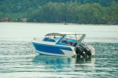 Speed boat on blue water. Boat - a speed boat on blue water Royalty Free Stock Images