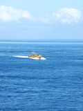 Speed Boat Drive through the Blue Water Stock Photography