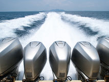 Speed Boat Engines. In a sea with full throttle speed royalty free stock photos