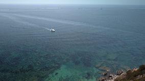 A speed boat fast approaching from the sea in Monte Argentario. Seen in an aerial view of the blue sea stock footage