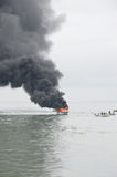 Speed boat on fire in Tarakan, Indonesia. TARAKAN, INDONESIA - Oct 31 : a speedboat carrying passengers between islands on fire during refueling on Oct 31, 2013 royalty free stock photo