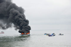 Speed boat on fire in Tarakan, Indonesia. TARAKAN, INDONESIA - Oct 31 : a speedboat carrying passengers between islands on fire during refueling on Oct 31, 2013 Royalty Free Stock Photos