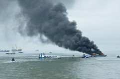 Speed boat on fire in Tarakan, Indonesia. TARAKAN, INDONESIA - Oct 31 : a speedboat carrying passengers between islands on fire during refueling on Oct 31, 2013 Royalty Free Stock Image