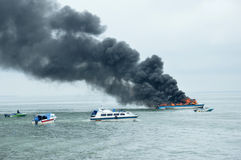 Speed boat on fire in Tarakan, Indonesia. TARAKAN, INDONESIA - Oct 31 : a speedboat carrying passengers between islands on fire during refueling on Oct 31, 2013 Stock Photography