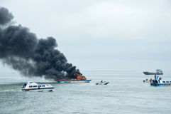 Speed boat on fire in Tarakan, Indonesia. TARAKAN, INDONESIA - Oct 31 : a speedboat carrying passengers between islands on fire during refueling on Oct 31, 2013 stock image