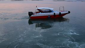 Speed boat floating for go out from jetty at sunset time stock video footage