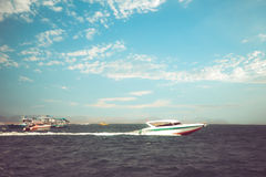 Speed boat floating in the ocean in summer. Royalty Free Stock Photo