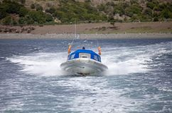 Speed boat in front of an island in Beagle Channel, Argentina royalty free stock image