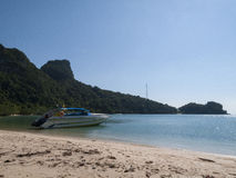 Speed Boat in the gulf of thailand. Idealic beach bay in the gulf of thailand with boat Royalty Free Stock Photo