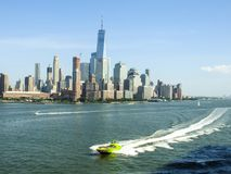 Speed Boat on the Hudson River Against New York City Skyline Royalty Free Stock Photo