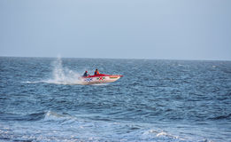 Speed boat jumping on water / Mandvi, Kutch, India - February 2017 - Tourist on speed boat stock image