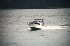 Speed boat at the lake in evening Stock Image