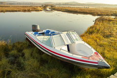 Speed boat at lake side Stock Image
