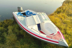 Speed boat at lake side in morning. Speed boat at lake side in a cold deep autumn morning Stock Photography