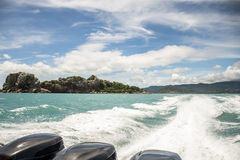 Speed boat motor water wave Beautiful rock sea with blue sky in Koh Samui Thailand. Speed boat motor water wave Beautiful rock and sea with blue sky in Koh Samui Stock Photography