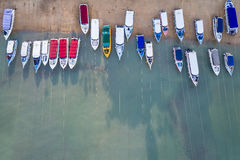 Speed boat parked on the beach at Chalong bay, Phuket province,. Top view speed boat parked on the beach at Chalong bay, Phuket province, Thailand. Aerial view Royalty Free Stock Photo