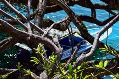Boat in the shadows in Lake Toba, Indonesia. stock photo