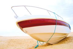 Speed boat resting on a beach Stock Image