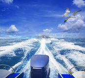 Speed boat running from lonely island use for travel, journey va Stock Photography