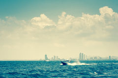 Speed boat runs on the sea with cloud and sky - vintage style Stock Photo