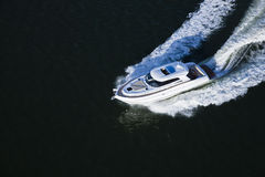 A speed boat in the sea. A beautiful white speed boat sailing in a dark sea Royalty Free Stock Photos