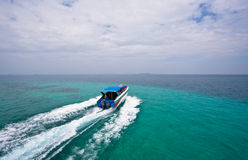 Speed boat in the sea two colors Royalty Free Stock Photography