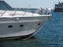 Speed boat in seaport. Bowsprit of luxury speed boat in seaport Royalty Free Stock Photos