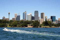 Speed Boat and Sydney skyline. Speed Boat and CBD in Sydney Harbour, Australia Royalty Free Stock Photo