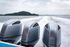 Speed boat with three engines with track wave from. Engines Stock Images