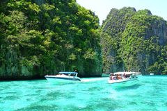 Speed boat and tourists is snorkel in the Andaman sea Royalty Free Stock Photo