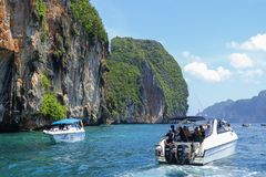 Speed boat and tourists is snorkel in the Andaman sea. PHI-PHI ISLAND, KRABI, THAILAND-APRIL 30,2017: Speed boat and tourists is snorkel in the Andaman sea at Stock Photo