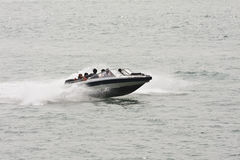 Speed boat with tourists in Xiamen, China Royalty Free Stock Photos