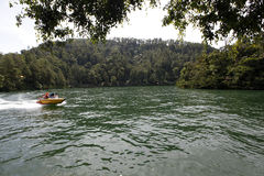 Speed boat. Traveler was renting a speed boat on a lake in Sarangan, East Java, Indonesia stock photography