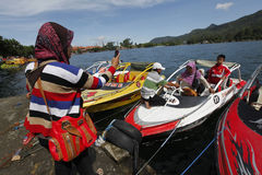 Speed boat. Travelers enjoy the water by renting a speed boat in Magetan, East Java, Indonesia stock photo