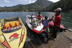 Speed boat. Travelers enjoy the water by renting a speed boat in Magetan, East Java, Indonesia royalty free stock photos