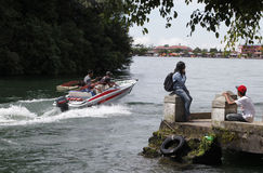 Speed boat. Travelers enjoy the water by renting a speed boat in Magetan, East Java, Indonesia stock photos