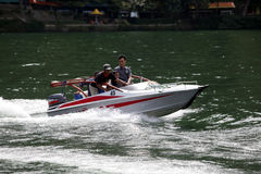 Speed boat. Travelers enjoy the water by renting a speed boat in Magetan, East Java, Indonesia royalty free stock photography