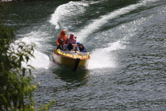 Speed boat. Travelers enjoy the water by renting a speed boat in Magetan, East Java, Indonesia stock image