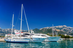 Speed boat waiting in the harbor. Deep blue sky Stock Images