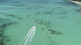 Speed boat or yacht sailing in the caribbean sea near Punta Cana beach stock video