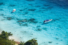Speed boats in crystal clear tropical sea Stock Photography