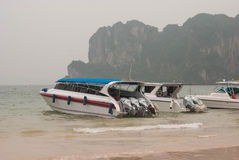 Speed boats and drivers waiting for tourists on the beach Stock Photography