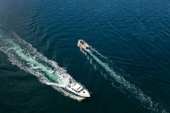 Speed boats on sea Stock Images