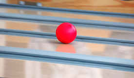 Speed bowling ball. Speed rolling red bowling ball Royalty Free Stock Photo