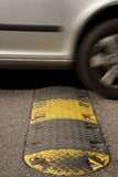 Speed bump. On a road when a car is passing Royalty Free Stock Photos