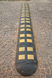 Speed bump. On cobbled roadway Stock Photo